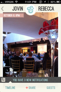 image of guests, head table and centrepiece inside the Wedding Party app